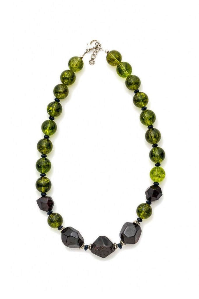 Deep red faceted Garnet, round marble Peridot and Sterling silver spacer.
