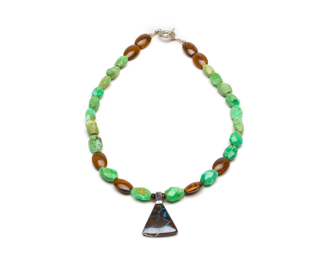 Australian Boulder Opal pendant set in Sterling silver bail, with lots of great Opal veins