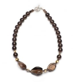 Beautifully cut faceted Smoky Quartz in the center, surrounding with smooth round Quartz and accentuated with vintage Crystal in gold tone